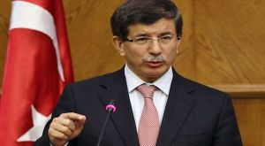 Turkey's Foreign Minister Davutoglu speaks during his joint news conference with his Jordanian counterpart Judeh at the foreign ministry in Amman